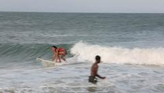 Woman learning to surf on tropical coastline waves Stock Footage