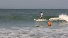 Sri Lankan surfer riding a wave in Arugam Bay Stock Footage