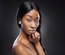 young black woman with long hair - stock photo