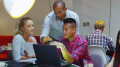 Young students learning I.T. skills at an adult education center - stock footage