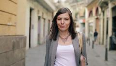 Confident beautiful woman walking in the city, steadicam shot HD - stock footage
