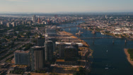Stock Video Footage of Wide aerial shot of Downtown Portland seen from the Ross Island Bridge
