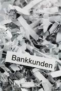 shredded paper bank customers - stock photo