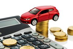 cost of the car. with calculator - stock photo