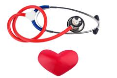 Stethoscope and a heart Stock Photos