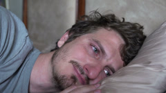 Sad man missing someone while laying in bed Stock Footage