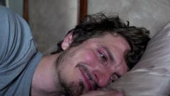 Very upset man crying in bed Stock Footage