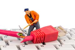 Workers, network connector, keyboard Stock Photos