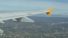 Vibrating wing of Airbus A321 over the coast near Faro Portugal. Stock Footage