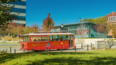 Tourist Trolley/Bus Tour Driving in the City of Asheville, NC Stock Footage