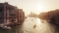 Boats and buildings on the Grand Channel at sunrise, Venice, Italy - stock footage