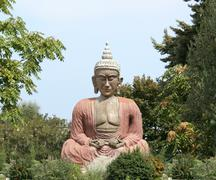 buddha sitting in meditation - stock photo