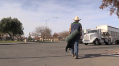 Cowboy on the road, rest stop Stock Footage