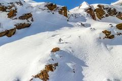 Skier in the rocks Stock Photos