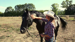 Young Woman with Black Stallion Horse Stock Footage
