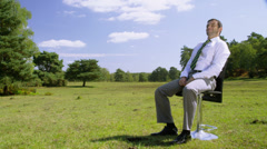 Businessman enjoying the freedom of nature. Environmental business concept Stock Footage