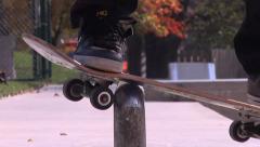 Skater does boardslide with skateboard Stock Footage