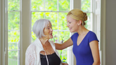 Portrait of happy smiling grandmother and granddaughter together at home Stock Footage