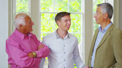 Portrait of three generations of happy handsome men from the same family Stock Footage