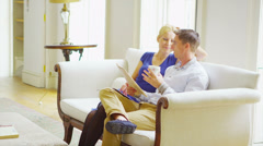 Attractive young couple relaxing together in elegant home - stock footage