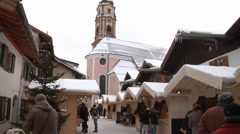 Christmas market stalls in Mittenwald. People eating and enjoying winter market Stock Footage