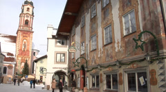 Mittenwald, view of the painted house and a church of Sankt Peter and Paul. Stock Footage