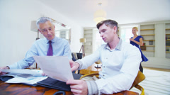 Businessman or CEO working at his desk with the support of two assistants Stock Footage