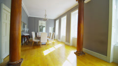 View of elegant dining room and living area in stylish classically designed home - stock footage