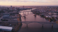Stock Video Footage of Wide aerial shot following the Willamette River over the Ross Island Bridge