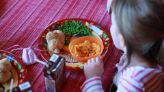 Little girl eating macaroni Stock Footage