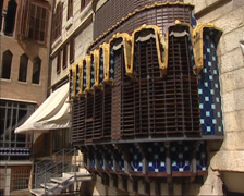 BARCELONA -  tilt up back facade Guell Palace by Gaudi Stock Footage
