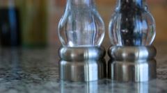 Salt and pepper shakers in the kitchen Stock Footage