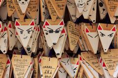 fox shaped praying cards at fushimi inari shrine in kyoto - stock photo
