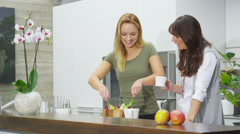 Happy female family & friends preparing a meal with freshly baked bread Stock Footage