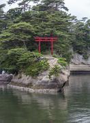 A single torii gate on an island in matsushima, japan. Stock Photos