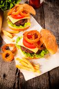 Cheeseburger and onion rings Stock Photos