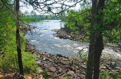 portage around a rapids - stock photo