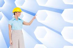 Composite image of smiling attractive architect pointing - stock illustration