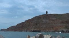 Lighthouse harbour coastline cliff navigation  rough postcard ocean sea coast  Stock Footage
