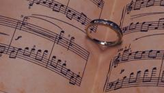 Book, ring, music and heart. love. wedding Stock Footage