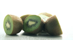 Stock Video Footage of Still life with spinning kiwi fruit isolated on white background cutout