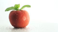 Stock Video Footage of Still life with spinning red apple and mint isolated on white background cutout