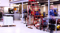 Modern manufacturing industrial workplace. Busy workers on the shop floor Stock Footage