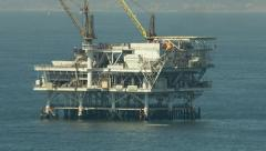 Stock Video Footage of Aerial shot of off shore oil platforms
