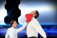 Stock Illustration of Composite image of businesswoman hitting a businessman with boxing gloves