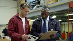 Workers in delivery warehouse factory Stock Footage