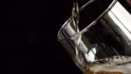 Beer is pouring into a glass Stock Footage