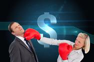 Stock Illustration of Composite image of businesswoman hitting colleague with her boxing gloves
