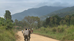 Village road and bicycles in africa Stock Footage