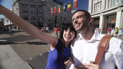 Attractive couple sightseeing in the city of London, UK Stock Footage